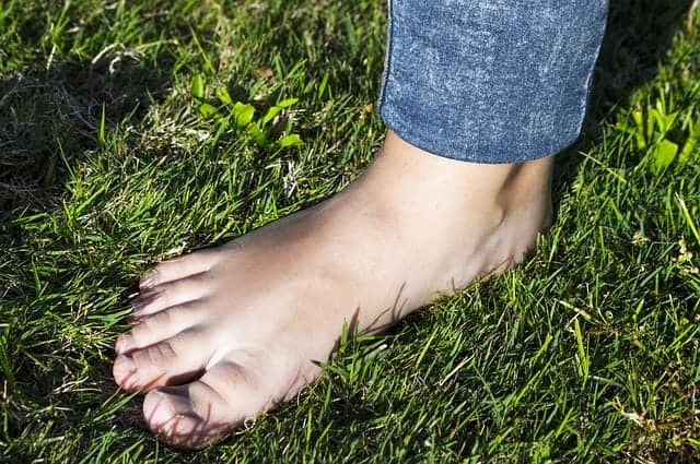 Get ground with bare foot in grass